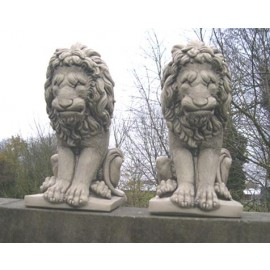 Large sitting lion statues (pair)