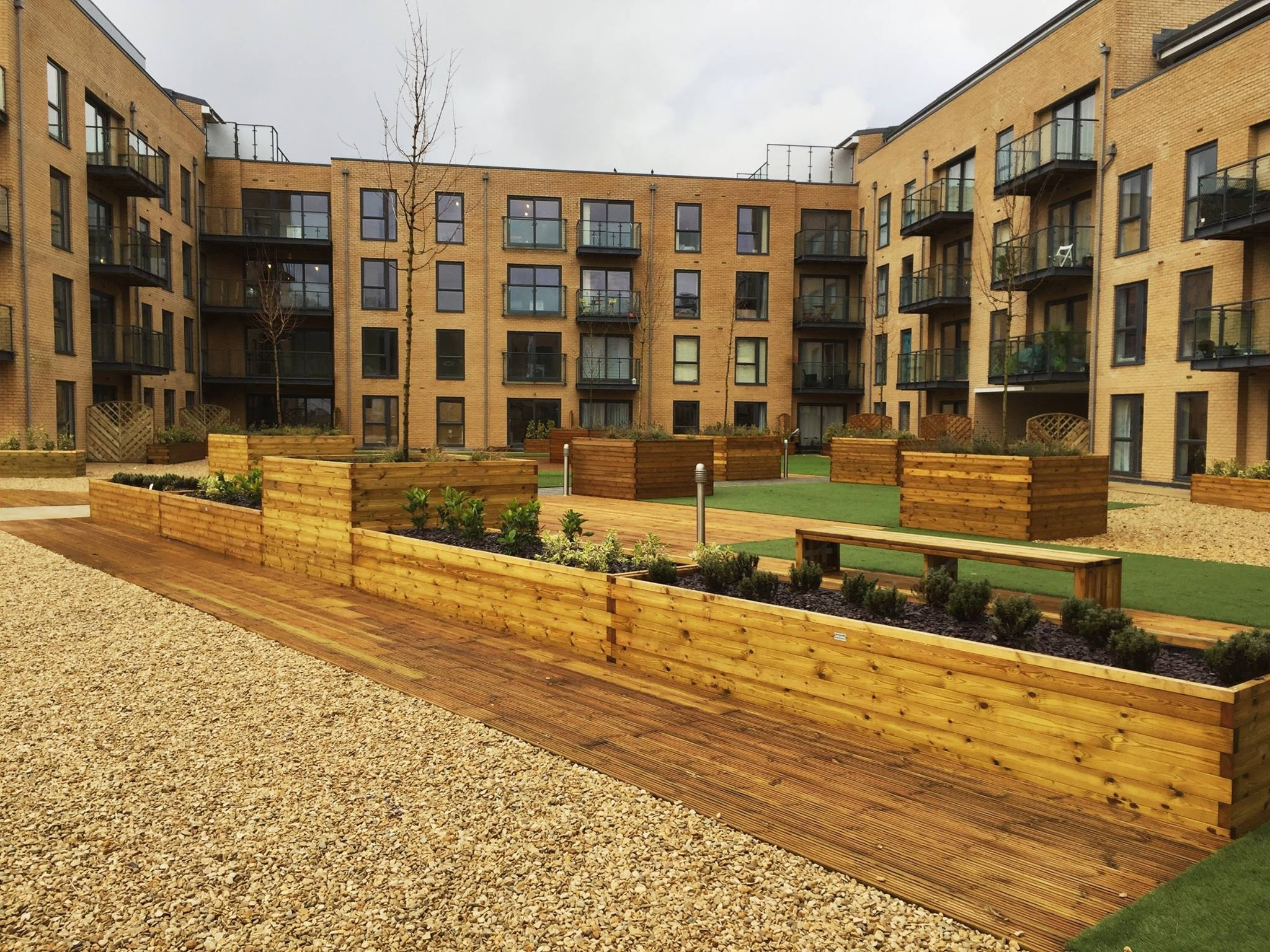 Bellway Homes communal area with high quality planters