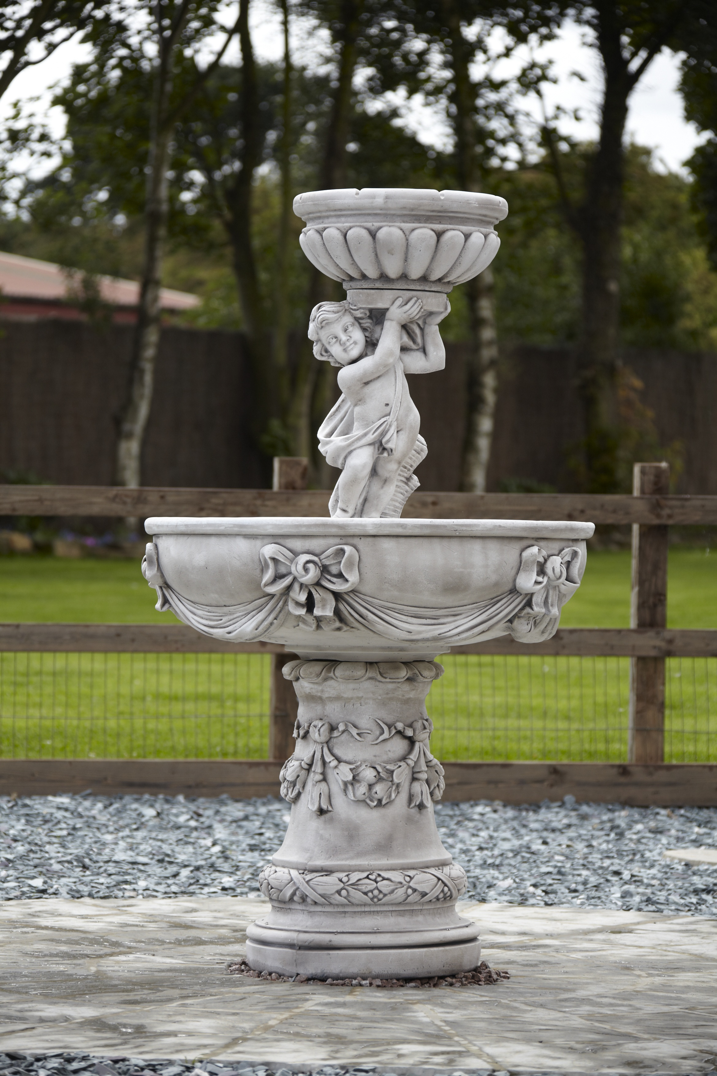 Classically detailed stone water fountain